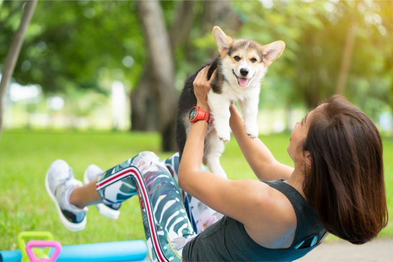 woman exercising with pet